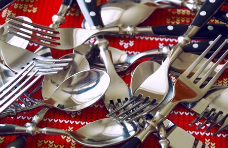 disrupted: spoon fork and knife on red back floor