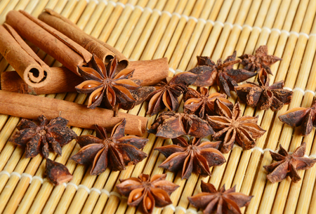 cinnamon with bamboo placemats background (soft focus, lens blur)