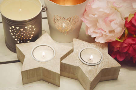 candle holder: wooden star candle holder with plastic flower Stock Photo