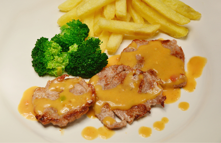 sizzle: Pork Tenderloin menu with mushroom sause and French fries