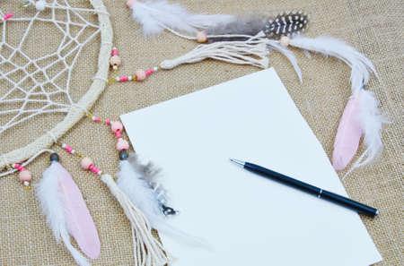 do it: Dream it. Do it. Dream catcher with paper and pen. (Soft focus, lens blur)