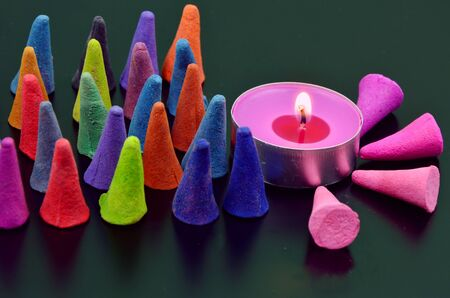 frankincense: colorful incense or frankincense with candle (soft focus, lens blur) Stock Photo