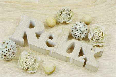 potpourri: Relax carved wooden letters and potpourri (vintage) soft focus, lens blur Stock Photo