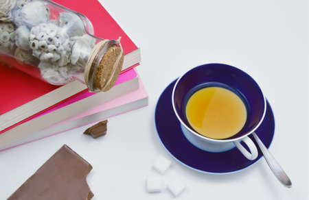 potpourri: tea and chocolate on the table with book and potpourri. relax time.