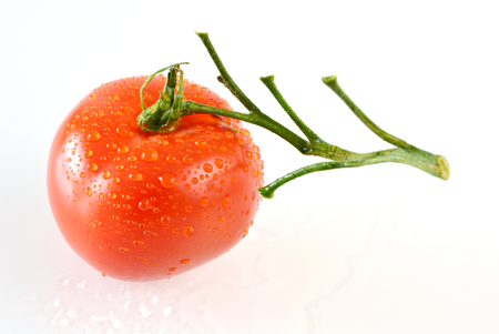 beneficial: Tomato is packed full of beneficial nutrients. (Soft focus, lens blur) Tomato with white background.