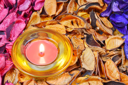 potpourri: candle, candle light and colorful, various scents of potpourri Stock Photo