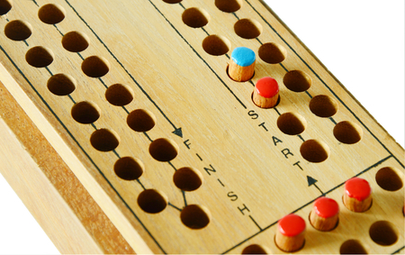 ludo: The beginning to victory. wooden Ludo gameboard. Stock Photo