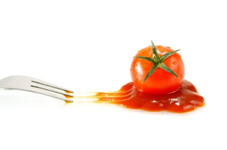 Tomato and ketchup with white background. Vegetables and condiment did people around the world know and use it.