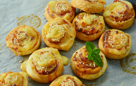 puff: Easy puff pastry menu. Bacon & Cheese Puff Pastry Rolls. Stock Photo