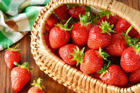 10 Super Health Benefits of Strawberries. Strawberries in basket on the wooden table.