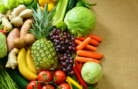 rabi: Colorful and various types of vegetables and fruits on sack background. Natural food for a better life.