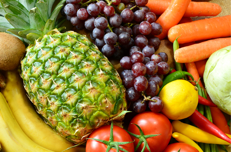 Colorful and various types of vegetables and fruits on sack background. Natural food for a better life.