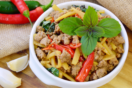 Beef Basil Thai Stir Fry. Spicy fried minced beef and bamboo shoots with basil leaves or Pad Ka Prao (Thai name)