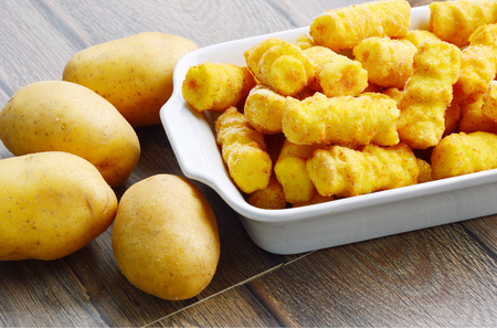 Frozen potato croquettes Cylindrical or German name is croquettes. Stock Photo