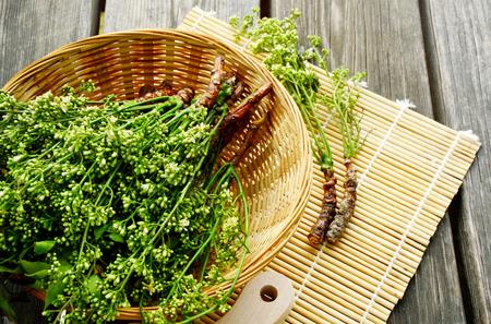 Azadirachta indica flower in basket on wooden background