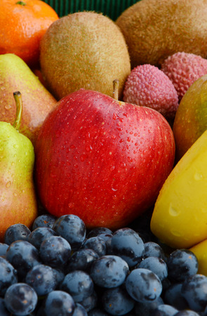 Mixed many type of fruits with full frame and vertical photo.