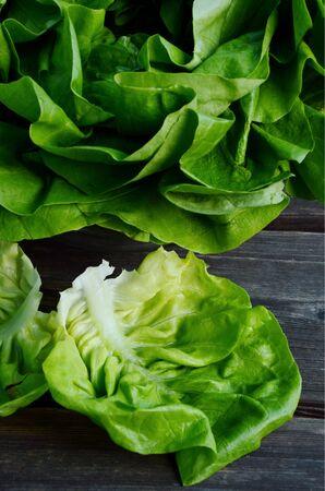 leave from butterhead lettuce on wooden floor