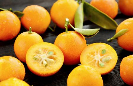 Kumquats or cumquats with water