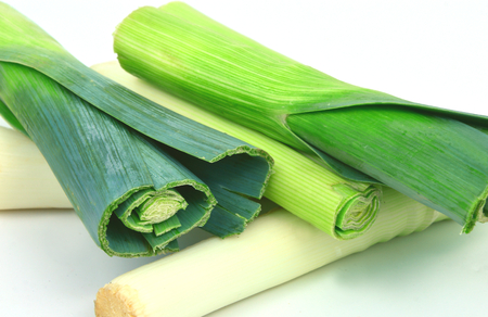 many leeks on white background