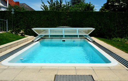 Private swimming pool at home with swimming pool roofing sheet Editoriali