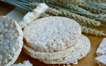 Organic white rice waffles on oven paper Banque d'images
