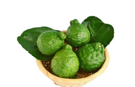 crimson lime or kaffir lime (citrus hystrix) in basket on white background Stock Photo