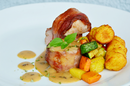 enderloin around with bacon gravy and croquette, vegetable