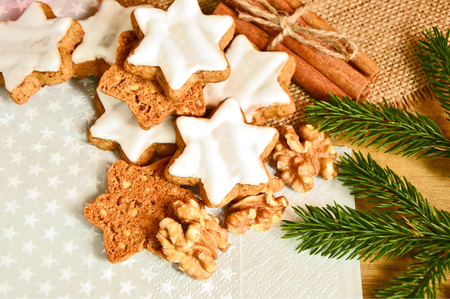 cinnamon star cookies (German name is Zimtsterne) with Christmas tree and decoration
