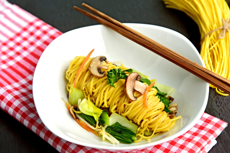 Stir fried noodles vegetarian or Fried Long Life Noodles (Thai name is Pad Mee Sua) Stock Photo