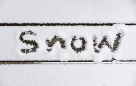 Snow with text on wooden floor.