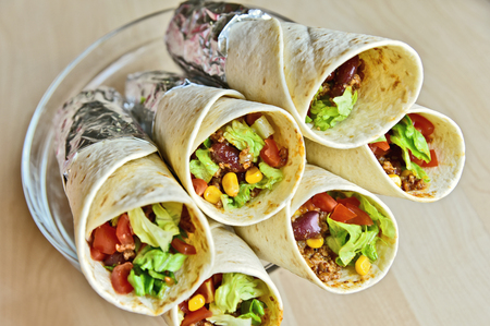 Colorful of Burrito roll close up  wrap with aluminum foil.