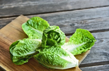 A lot of fresh Romaine lettuce on wooden floor. Stok Fotoğraf