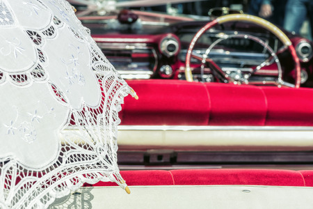 lacey: White Lace Umbrella in Vintage Car. Vintage car ready for a drive on a sunny day.