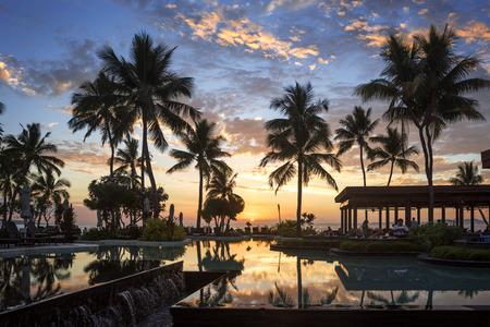 Fiji Sunset Palm Trees Beach Bar - Hotel beach bar looking at the Fijian sunset Stock Photo