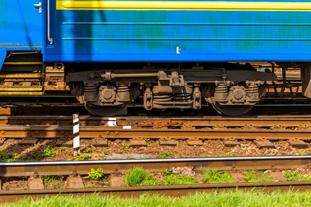 wheel of a modern passenger car of a train, wheels of a train on rails