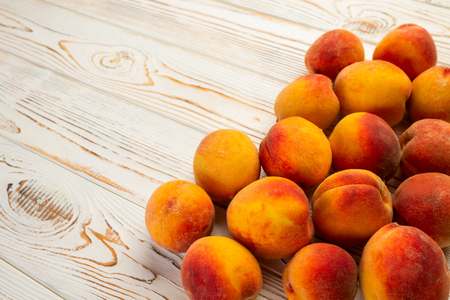 fresh peaches in a plate on the table