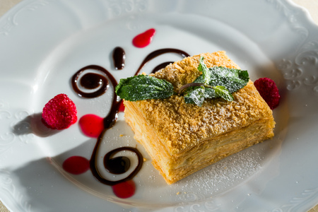 Napoleon puff pastry, cake with a creamy padding and a puff pastry flavored with chocolate mousse and berries