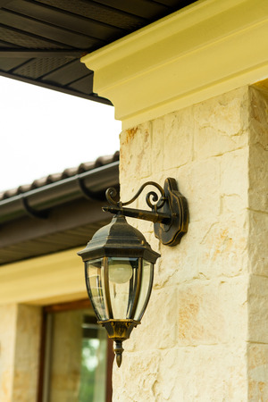 street metal wall lamp on the building wall Stock Photo