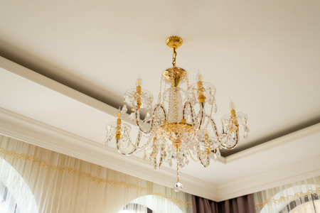 Crystal chandelier in the interior on the ceiling Stock Photo