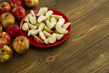 ripe sliced apples on a table in a plate sliced