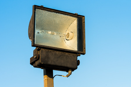 all-weather halogen street lamp close up against the sky