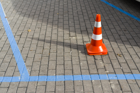 car markings on a stone tile with an installed car cone Stok Fotoğraf