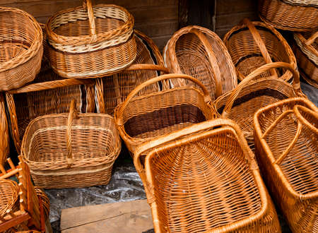 baskets made of hand-made vines grouped for sale at a folk art exhibition Stock Photo