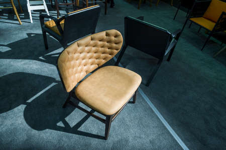 store arm-chairs, stylish modern chairs in a furniture store
