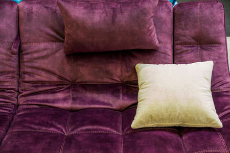 different textures of upholstery fabric on cushions for a sofa, a pillow on the sofa, an element of decor in the interior Archivio Fotografico