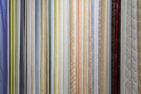 fabric samples in the textile store, examples of upholstery fabric for furniture