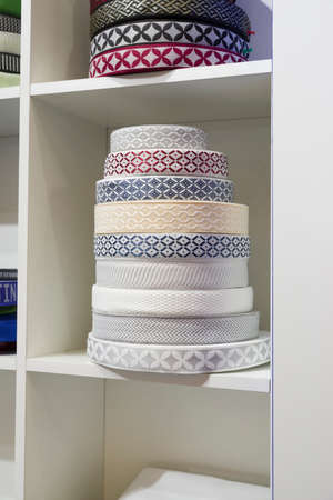 colored textil ribbons and embroidery on the shelves