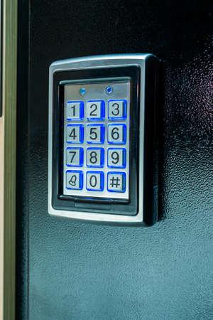 Metal intercom on the iron door