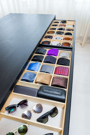 Neckties and belts in the wardrobe