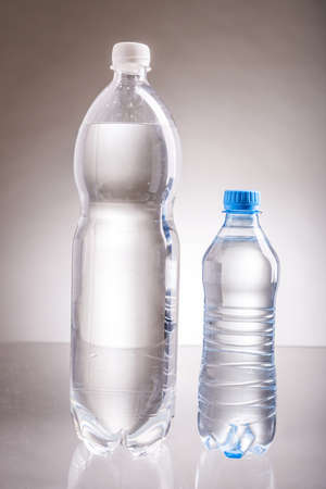 clear water in plastic bottles, water in plastic containers in the studio